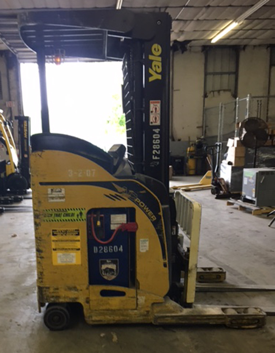 1988 Clark NP300-30, 3000 Lb Capacity, Reach Truck for Narrow Aisle stacking, 95/210 Three Stage Mast with Side Shift, this machine runs well and comes with a Battery and a Charger, available now